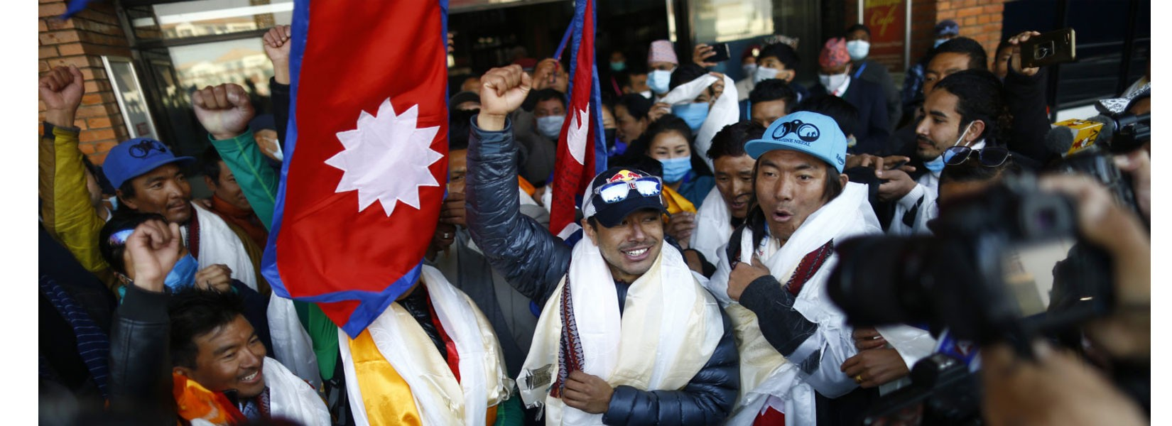 K2 winter expedition team arrives back in Nepal to hero's welcome